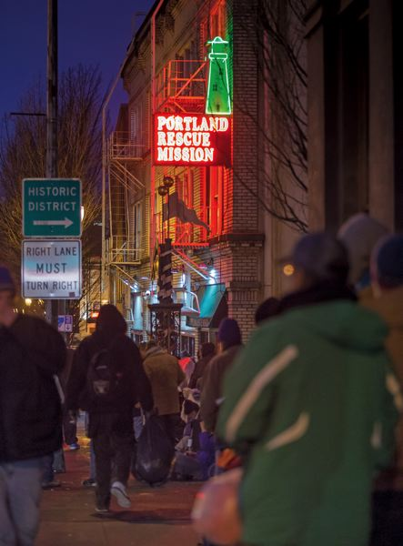 by: TRIBUNE PHOTO: JONATHAN HOUSE - The line runs long outside the Portland Rescue Mission before dinner is served in the evening.