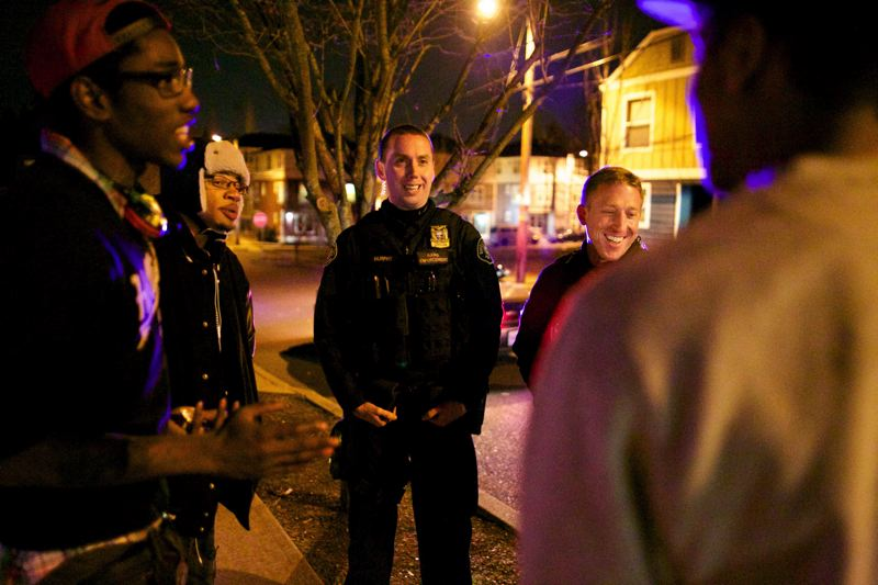 by: TRIBUNE PHOTO: JAMIE VALDEZ - Officers Brian Dale and Patrick Murphy share a laugh with Deshawn, Isaiah and a friend they stopped as part of the Gang Enforcement Teams community policing. First, the officers searched the youths for weapons.