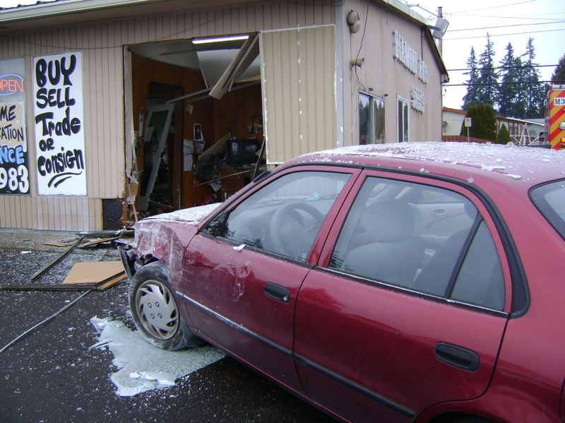 by: SUBMITTED PHOTO - A 1999 Toyota sedan, driven by a relatively new motorist, crashed into Diamond Auto Sales in Tualatin, police say.
