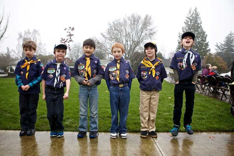 by: TIMES PHOTO: JAIME VALDEZ - Matthew Giles, 7, Travis Cantrell, 9, Mario Hernandez, 7, Anthony Carlson, 7, Noah Wesley, 7, and Thomas Hochstetler, 9, line up before the Wreaths Across America ceremony in Beaverton.