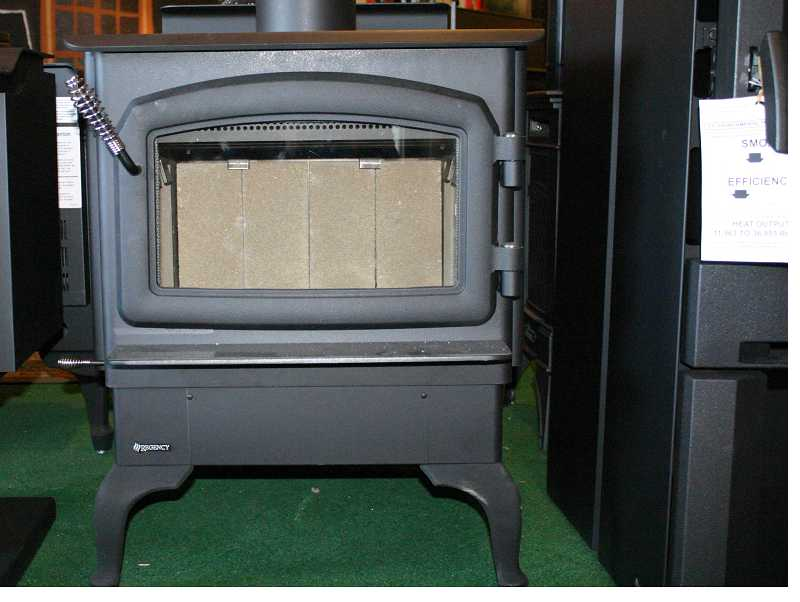 by: JASON CHANEY - The review could lead to stricter emissions standards for woodstoves like the one shown here.