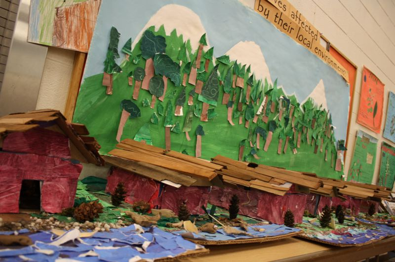 by: SPOTLIGHT PHOTO: ROBIN JOHNSON - Third-Grade Students in Asa Gervich's class at Sauvie Island Academy have constructed diorama of traditional Chinook villages, which they add to as they continue to learn about Native American Culture.