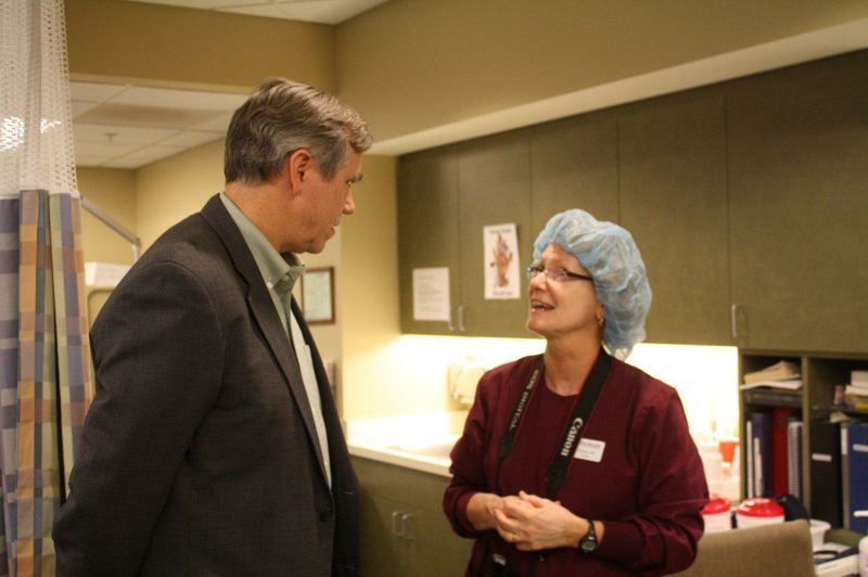 by: SUBMITTED PHOTO - Cherie Shevlin, ASC director at the Eye Health Eastside Surgery Center, takes Sen. Jeff Merkley on a tour of the Clackamas facility.