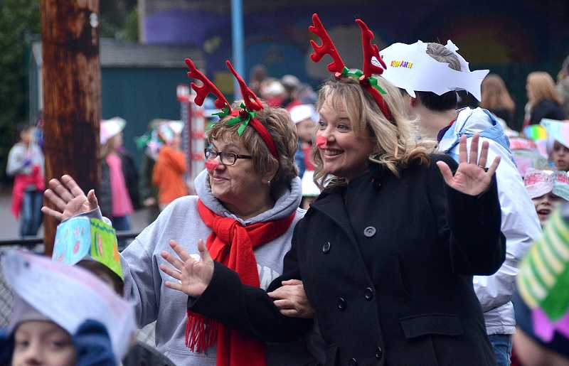 by: TIDINGS PHOTO: VERN UYETAKE - Dawna King and Sheila Powers get into the spirit of the event with reindeer antlers and noses.