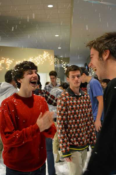 by: SUBMITTED PHOTO: SOPHIE RICHARDS - Lakeridge junior Nick Rooney, left, and junior Jonathan Grace smile at each other while Bryce Anderson, ASB president, passes by.