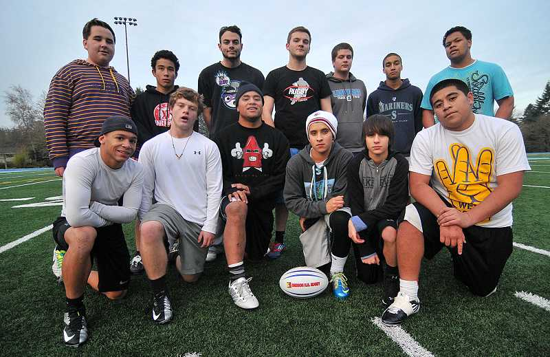 by: REVIEW PHOTO: VERN UYETAKE - Members of the Lakeridge High rugby team strike a pose.