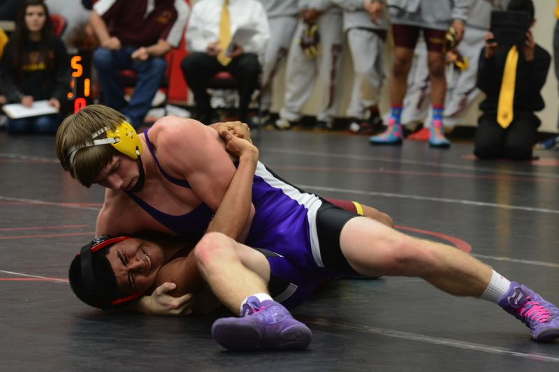by: TIMES PHOTO: MATT SINGLEDECKER - Sunset 160-pounder Logan Lachenmeier won his match against Forest Grove last Wednesday.