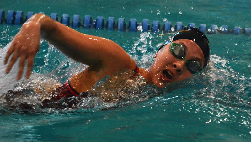 by: TIMES PHOTO: MATT SINGLEDECKER - Southridge girls' swimmer Caitlyn Wilson won the 500 freestyle and helped the Skyhawk 200 free relay team take first at Southridge's home dual meet with Jesuit on Thursday. Wilson won three events on the day.