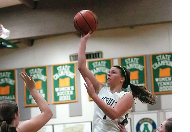 by: TIMES PHOTO: DAN BROOD - Jesuit sophomore Kate Anderson floats toward the basket during Friday's game against Sherwood.