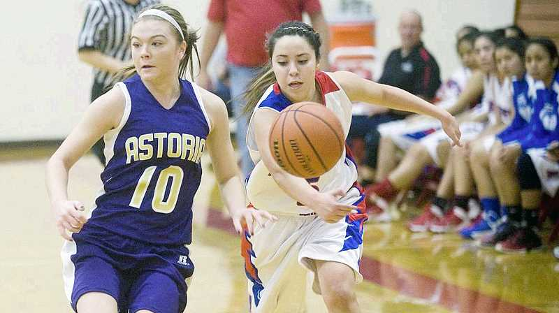 by: PHOTO BY ALEX PAJUNAS/DAILY ASTORIAN - Madras' Vanessa Esquivel (right) tries to outrun Astoria's Rylee Demander (left) for a loose ball during Thursday's action at the Seaside Holiday Classic basketball tournament.