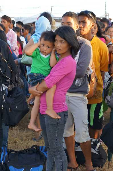 by: SUBMITTED PHOTO - A mother and child wait to be evacuated from Guiuan.