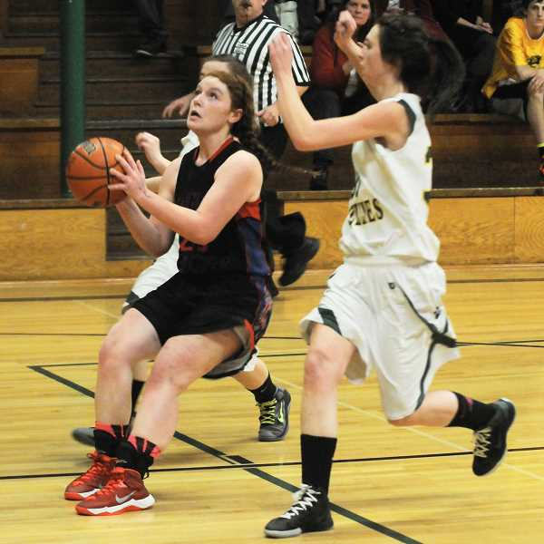 by: LON AUSTIN/CENTRAL OREGONIAN - Dori Ordway pulls up for a jump shot during Mitchell/Spray's loss to Gilchrist on Friday. Ordway led the Eagle/Loggers in scoring with eight points.