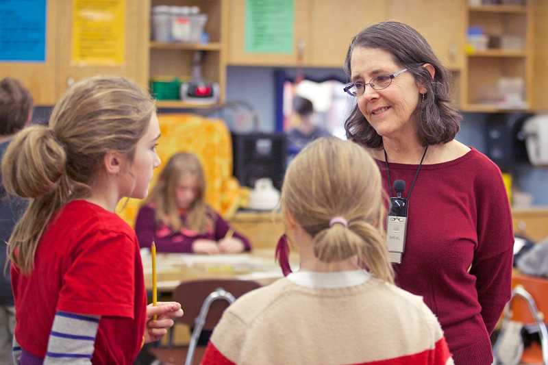 by: TIMES PHOTO: JAIME VALDEZ - Janice Avidan teaches math to her fourth-graders at Buckman Elementary School. Shes one of about 100 Portland Public Schools teachers who filed to retire last week. That trend doesnt seem to be the case in Tigard or Tualatin that saw few retirements this year.