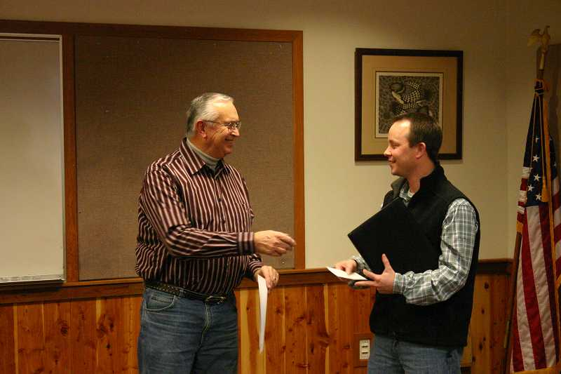 by: JASON CHANEY - Jeremy Green  (RIGHT) receives a check for After the Bell from Crook County Cultural Coalition board member, Lyle Andrews (LEFT).