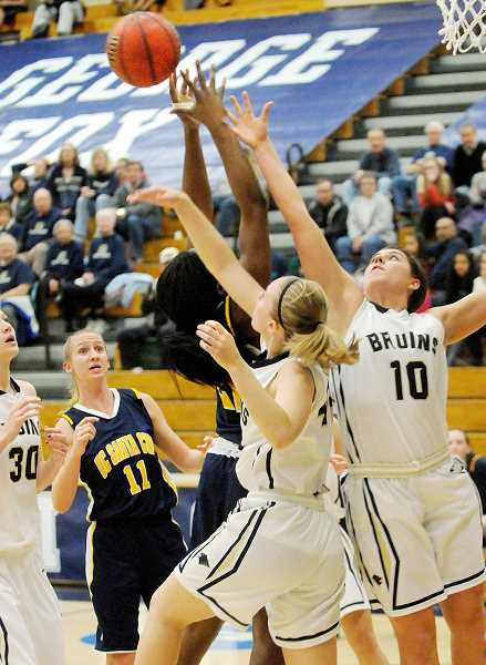 by: SETH GORDON - Not to be denied - Kennedy Hobert (center) and Kaycee Creech battle for a rebound during George Fox's 74-45 win over California-Santa Cruz on Friday at Miller Gym. The Bruins outrebounded the Banana Slugs 48-40 in the victory.