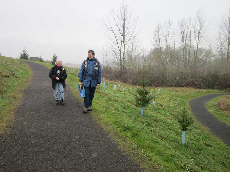 by: BARBARA SHERMAN - Sue Sutter, left, of King City and Judy Albertson of Sherwood head out on the main trail of the Tualatin River National Wildlife Refuge on a crips December morning in their role as volunteer rovers to answer visitors' questions and report animal sightings to the staff.