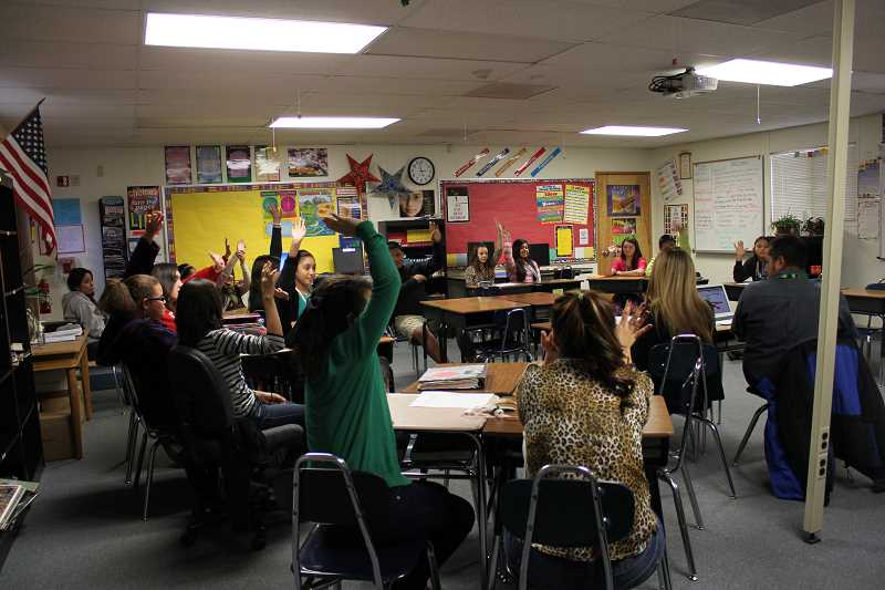 by: GEORGE ROBERTS - Members of French Prairie Middle School's student council, which was formed in October for the first time in recent years, cast votes during a recent student council meeting at the school. The student council recently voted to donate $212 raised by the school to AmeriCares' outreach program to victims of Typhoon Haiyan in the Philippines.