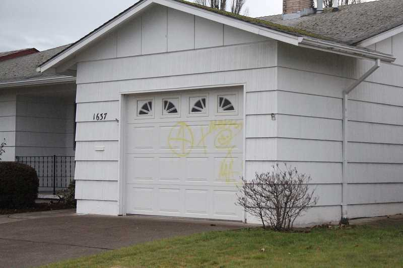 by: MAYGAN BECKERS - This house on Princeton Road was tagged Sunday night by vandals, police say.