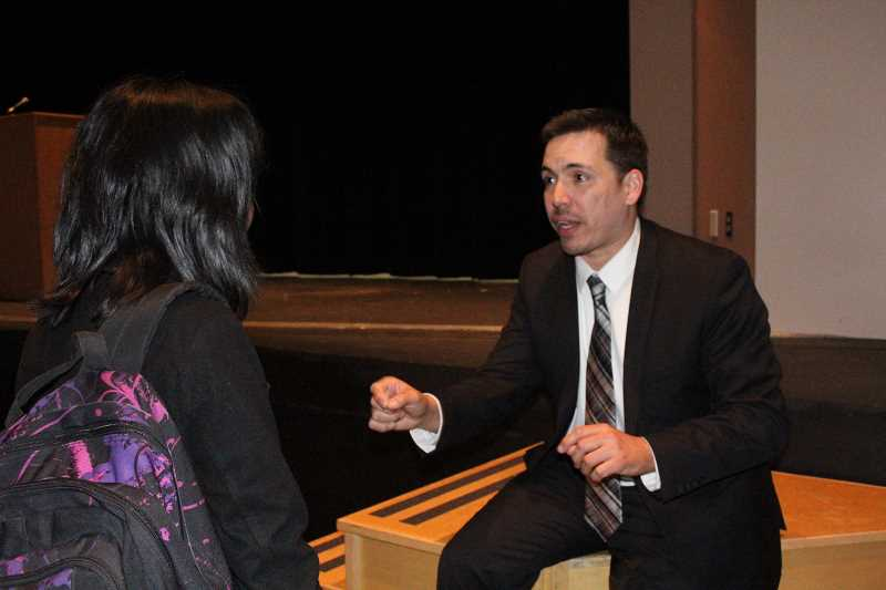 by: LINDSAY KEEFER - After his performance, Joaquin Zihuatanejo met with students, taking pictures and giving advice, like to this Academy of International Studies student on how to deal with writer's block.
