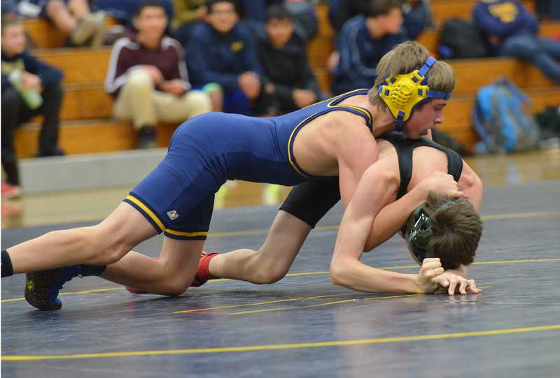 by: JEFF GOODMAN / FILE - Gus Warren (left) won the 106-pound bracket Dec. 21 at the Larry Owings Invitational tournament at Canby High School. Above, the Canby freshman competes during a Dec. 11 dual at home against Troutdale-Reynolds.