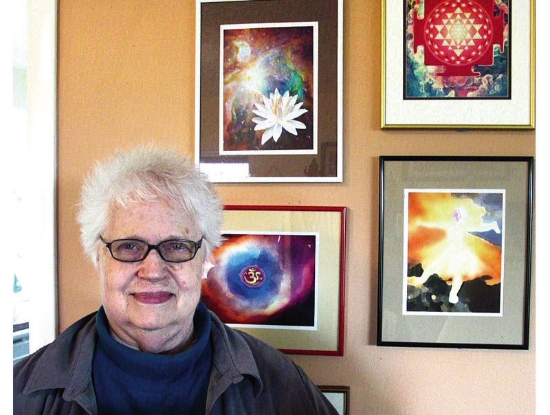 by: PHOTO: MERRY MACKINNON - Skyler Freimann recently published her book of artwork and spiritual teachings titled 'One With the Sofa: A Taoist Guide for the Physically Challenged.' Behind her are displayed examples of her digitally created cosmic art.