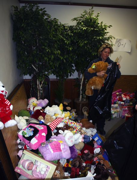 by: POST PHOTO: KYLIE WRAY - In addition to their two to three toys, each childs bag contained a donated book and a stuffed animal.