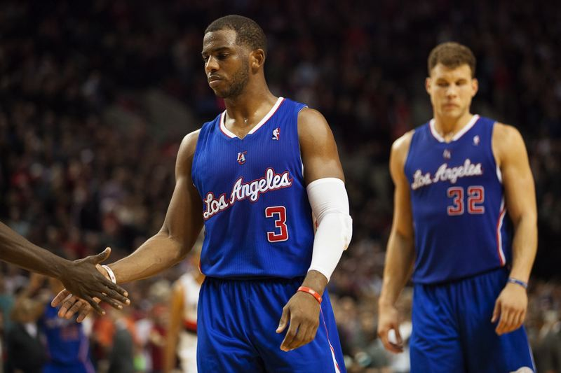 Chris Paul and Blake Griffin leave the court defeated.