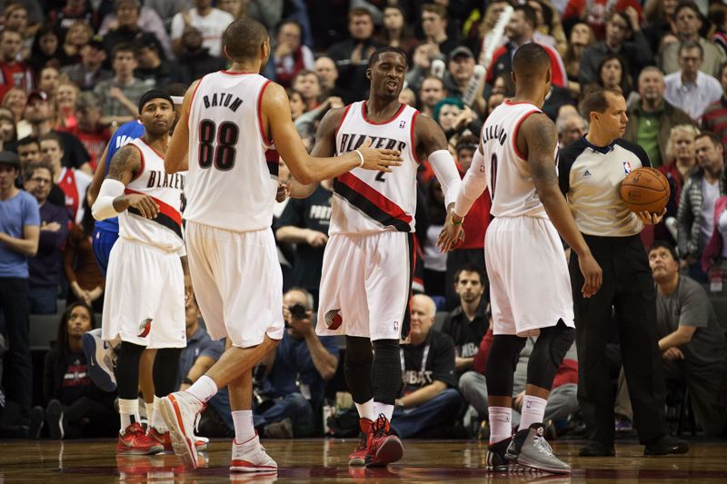 Blazers (from left) Mo Williams, Nicolas Batum, Wesley Matthews and Damian Lillard slap hands after a free throw.