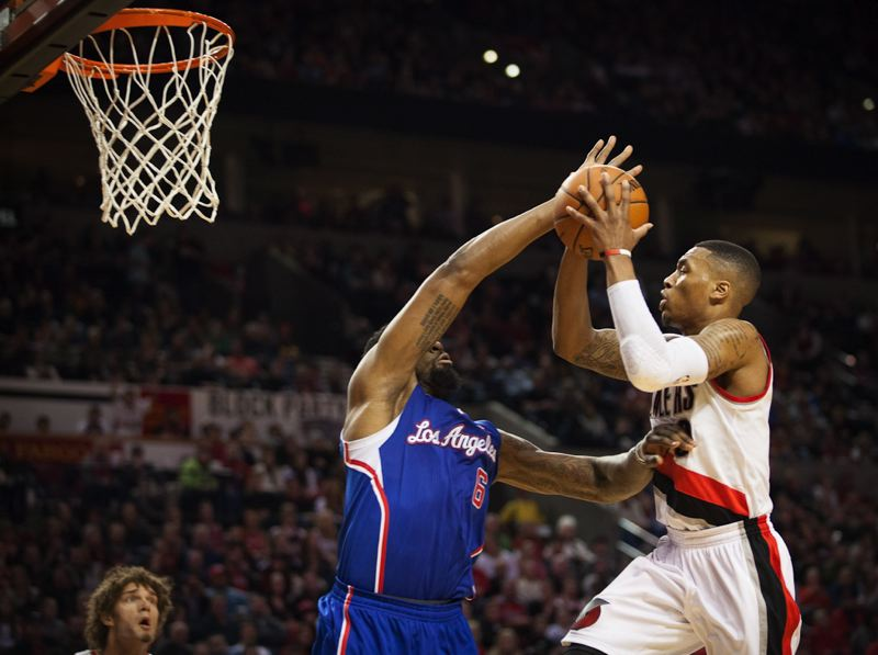 Damian Lillard gets around DeAndre Jordan of the Clippers.