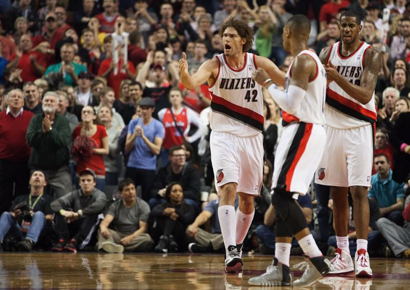 Blazers center Robin Lopez (left) gets fired up in overtime.