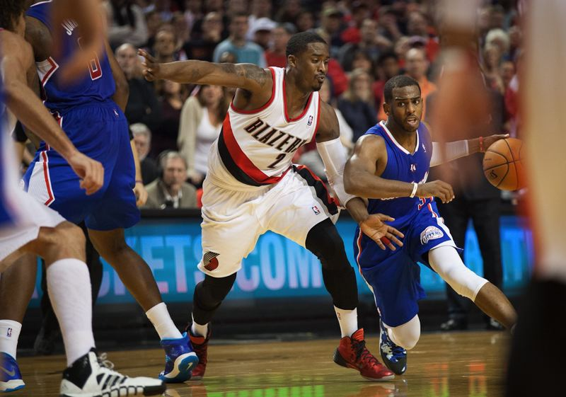 Wesley Matthews (left) works to stay up with Clippers point guard Chris Paul.
