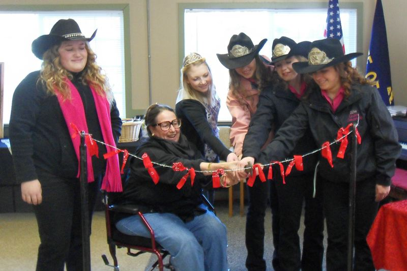 by: SUBMITTED PHOTO - From left, Katie Lobby, state Sen. Betsy Johnson, Kiara Single, Baylee Crawford, Ashley Lanphear and Savannah Dreyer cut a strand of barbed wire trussed with ribbon to mark the grand opening of the Warren Grange at the Columbia County Fairgrounds 4-H Pavilion.