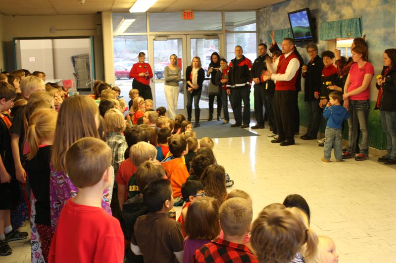by: SPOTLIGHT PHOTO: ROBIN JOHNSON - Grant Watts Elementary School students presented more than 150 toys to the Scappoose Rural Fire District's Share and Care toy drive Friday, Dec. 20. Tami McDonald, counselor with Grant Watts Elementary, said most students at the school have the option to either do a toy exchange between their peers or to each donate a toy to the drive. Most of the school's students, McDonald said, choose to give to Scappoose's families in need during the holidays. 'This year we were cut a little short with snow days, but our kids rallied,' she said. The school also participates in an annual toy drive. This year, students raised 733 food items, surpassing their goal by 233.