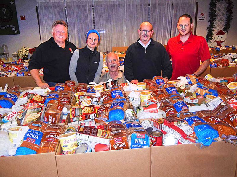 by: CONTRIBUTED PHOTO: ROLAND SMITH - Don Lewis, Gresham Elks treasurer, Sara Fisher of Human Solutions and three guests prepare Christmas food boxes for distribution among families in need in East Multnomah County.