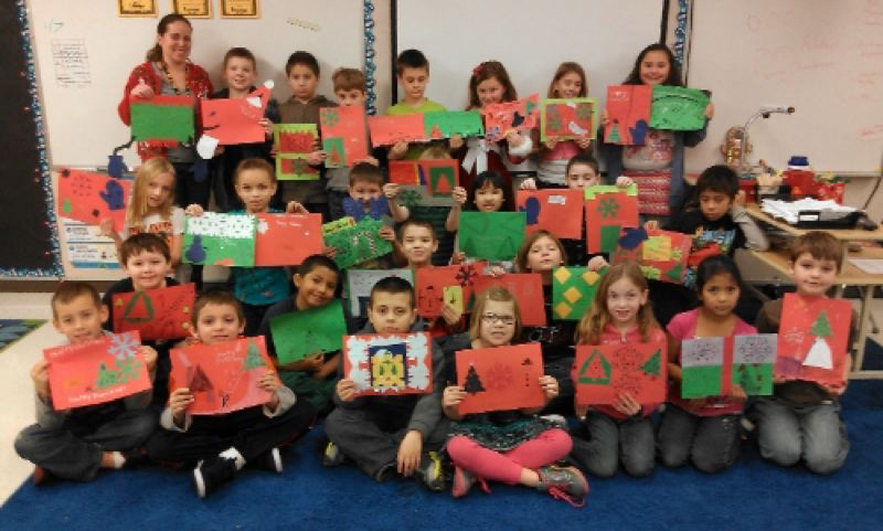 by: PHOTO BY: LESLIE ROBINETTE - Gladstone third graders in Miss Gillies' class decorated holiday placemats for homebound seniors served by Meals on Wheels.