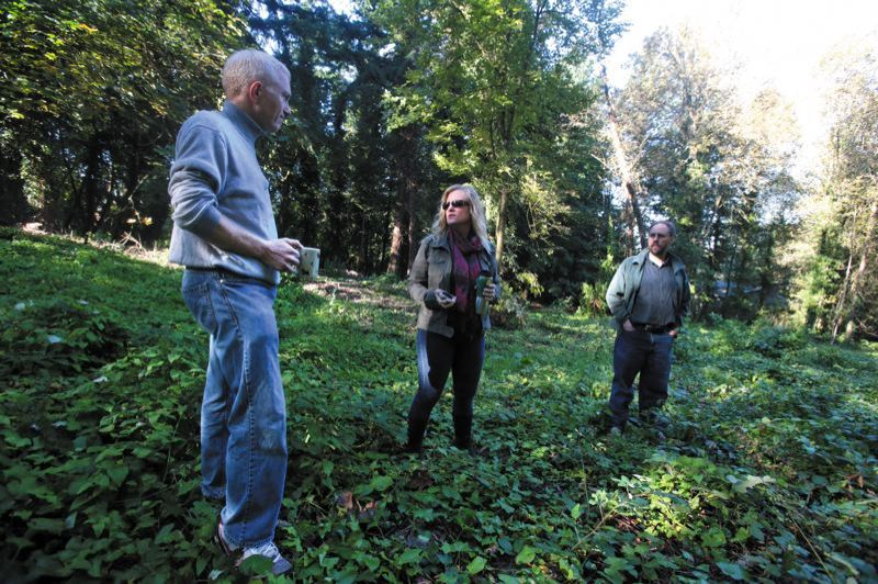 by: TRIBUNE PHOTO: JONATHAN HOUSE - Southwest Portland residents (from left) Jeremy Solomon, Terri Preeg Riggsby and Bill Kielhorn walked though the three-quarter acre city parcel they want preserved.