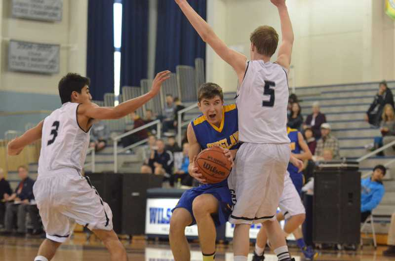 by: JEFF GOODMAN / PAMPLIN MEDIA GROUP - The Wilsonville boys basketball team fell to Silverton in the finals of its home tournament Dec. 28. Above, Zach Malvar (left) and Tyler Hieb defend during a previous win over Siuslaw.