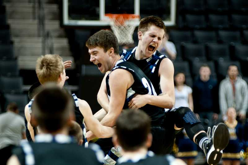 by: GREG ARTMAN - Dylan Livesay is mobbed by Andrew Phillis (right) after hitting the game-winning three-pointer to lift the Wilsonville boys basketball team over West Albany in the fourth-place game of the Class 5A state tournament in Eugene. It was one of the landmark moments in Wildcats sports in 2013.