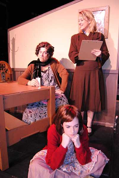 by: COURTESY PHOTO: THEATRE IN THE GROVE - Annie played to sold-out crowds at Theatre in the Grove this December, with Jeanna VanDyke starring as Miss Hannigan, Mackenzie Gross as Annie and Jennifer Yamishiro as Grace.