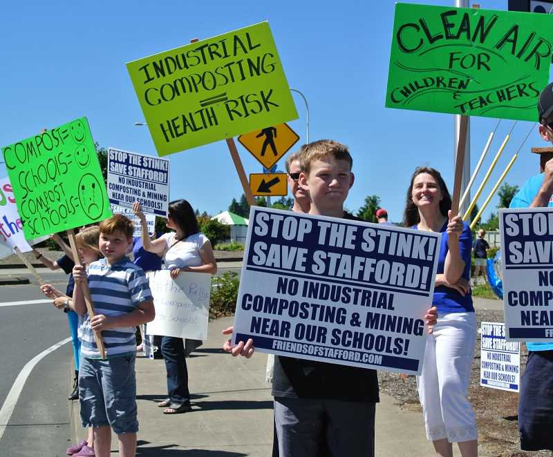 by: SUBMITTED PHOTO - Local residents protested against a proposed composting facility across from Stafford Primary School. A bill signed in June took those composting plans off the table.