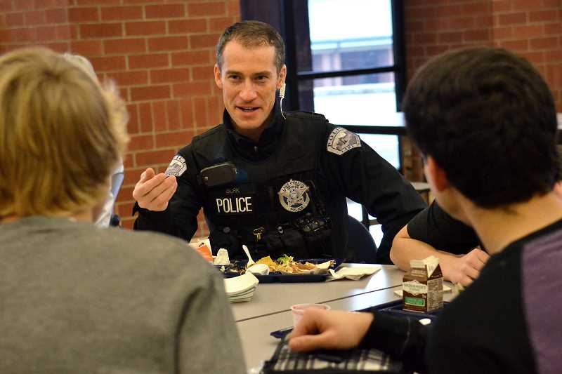 by: REVIEW FILE PHOTO - Lake Oswego Police Officer Nathan Burk is among law enforcement officers who have been eating lunch with Lake Oswego High School students. His visit was part of a program bringing a stronger police presence into local schools in 2013.