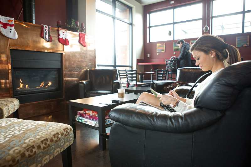 by: TIMES PHOTO: JAIME VALDEZ - Hayley DeBois,a senior at Tualatin High Schoo,l enjoys going to Metro Perc because it's much quieter than other coffee houses.