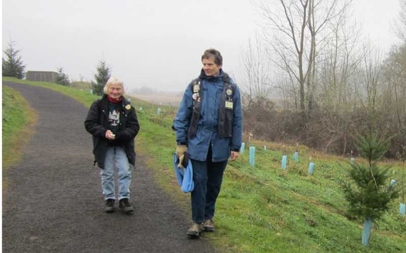 by: BARBARA SHERMAN - TWO FOR THE ROAD -Sue Sutter (left) of King City and Judy Albertson of Sherwood head out on the main trail of the Tualatin River National Wildlife Refuge on a crisp December morning in their role as volunteer rovers to answer visitors' questions and report animal sightings to the staff.