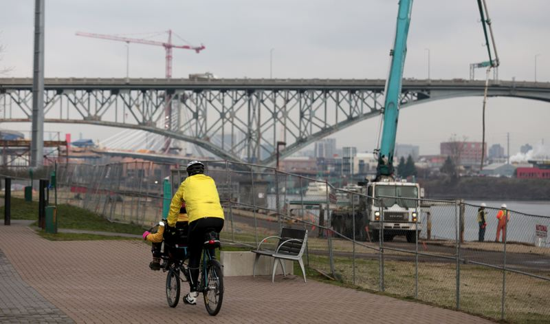 by: PAMPLIN MEDIA GROUP PHOTO: JONATHAN HOUSE - Cyclists pass the South Waterfront Greenway, an ongoing revitalization project.