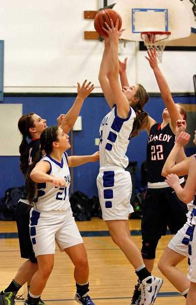 by: PHIL HAWKINS - Glass cleaner -- St. Paul forward Cassidy Merten skies for a rebound during the Bucks' 49-36 loss to unbeaten Kennedy at home on Friday.