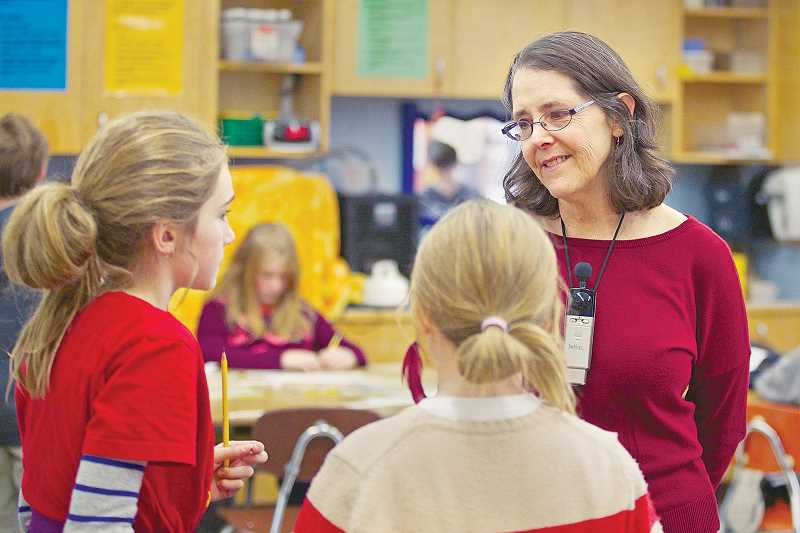 by: JAIME VALDEZ - One of many to leave -- Janice Avidan teaches math to her fourth-grade students at Buckman Elementary School. She's one of about 100 Portland Public Schools teachers who filed to retire in December, the highest number in several years.