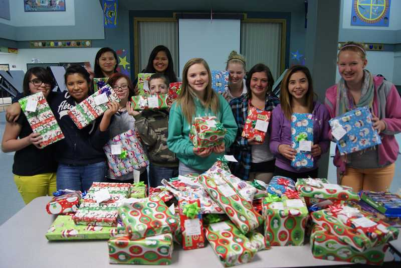 JCMS students wrap gifts for the toy drive.