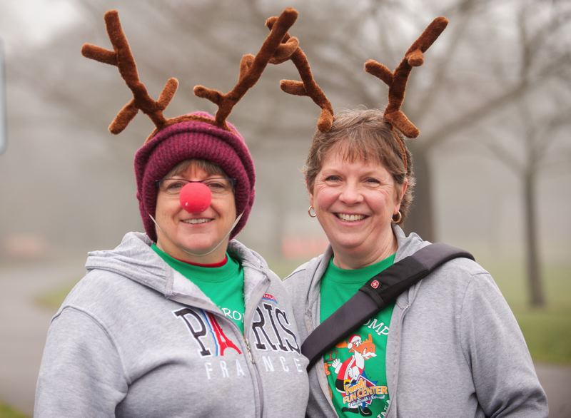 by: SPOKESMAN PHOTO: JOSH KULLA - Wilsonville City Councilors Julie Fitzgerald (L) and Susie Stevens are shown here in festive garb at the city-sponsored Reindeer Romp last month. But their first year on the council has shown they are all business when it comes to the issues facing the city and have helped swing the balance of power on that body.
