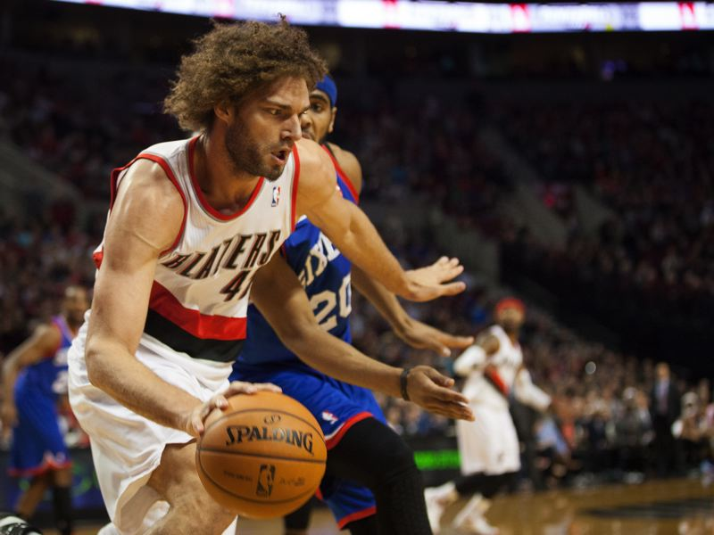 by: TRIBUNE PHOTO: MEG WILLIAMS - Trail Blazers center Robin Lopez makes a move in Saturday's game against Philadelphia.