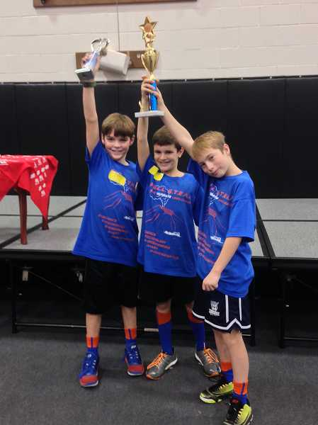 by: SUBMITTED PHOTO - Wilsonville's Full STEAM Lego robotics team, including fifth-graders Caden Keyston, Kullen Whittaker and Camden Miller, took second place overall at the Mentor Graphics qualifying tournament Dec. 15 and will advance to the state championship this month.